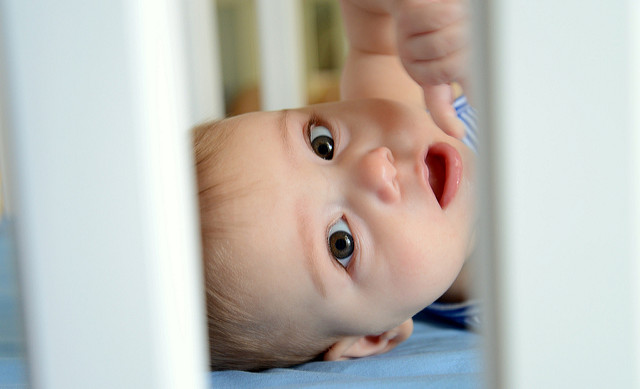Photo of a tiny baby in a crib
