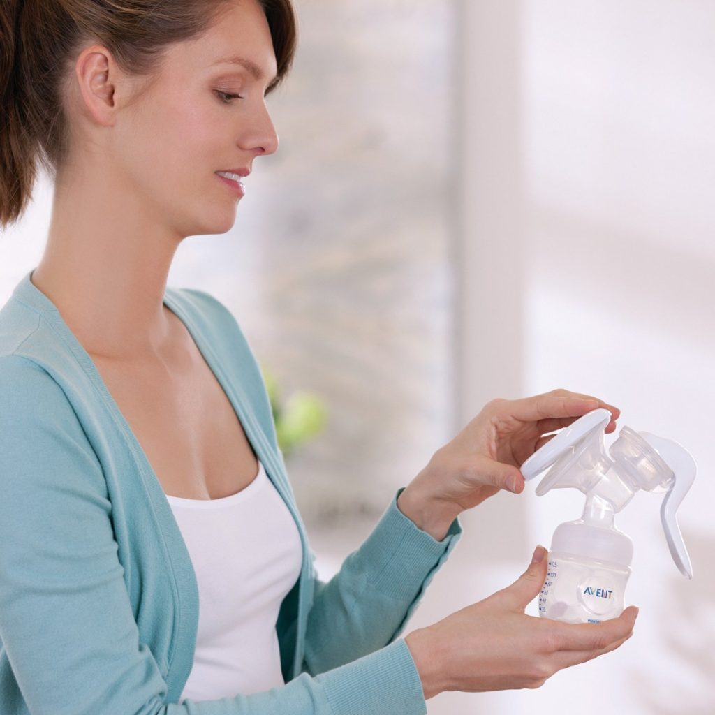 Lady using her Philips Avent Manual Comfort Breast Pump