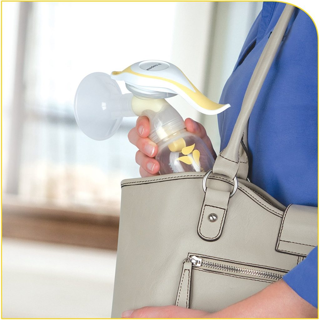 Photo of the Medela Manual Breast Pump for working moms in a tote bag